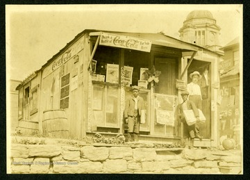 Two African-American Newsboys and Unidentified man stand outside C. N Chilins, located on Madison Ave. Fairmont, W. Va...eventually (relocated) to the first floor of Watson Hotel.