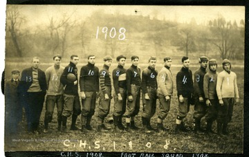 Members of Clarksburg High School Foot Ball Squad pose in the field from right to left: 1) W. Shinn; 2) R. Coffman; 3) R. Custer; 4) G. Curtin; 5) C. Osborn; 6) O. Oesterly; 7) F. Ruttencutter; 8) R. Graham; 9) W. Jacobs; 10) W. Garret; 11) R. Harrison; 12) G. Williams and 13) F. Hugill.