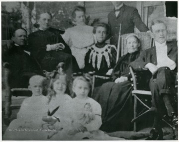 'A.B. Fleming, Carrie Watson Fleming, Ida Fleming Miller, Gypsy Fleming Ward, Charles Edwin Ward, Rhoda Brooks Fleming, Brooks Fleming, Jr., Helen Quarrier Miller, Caroline Brooks Ward, Margaret Fleming Ward at Oak Hall (A.B. Fleming's summer home in Oakland, Maryland).'