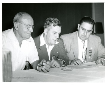 Secretary Andrews (left), Pritchard Dillon--President Huntington CLU (center) and President Carter (right) at Huntington Convention in 1951.