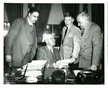'Federations prize essayist meets President Truman--John Dean, 16, Charleston's Stonewall Jackson high school student who submitted prize-winning composition in the federation's 1947 essay contest, visits President Harry Truman at the White House in company with President E. A. Carter (left) and West Virginia Senator Harley M. Kilgore (right).