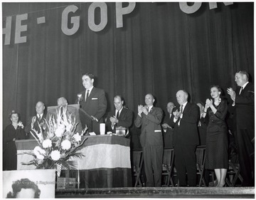 'Foreground - Governor Cecil Underwood; Background (Left to Right) - Mrs. Cecil Underwood, (?), Senator Chapman Revercomb, (?), Senator John D. Hoblitzell, Jr., (?), (?), (?)'