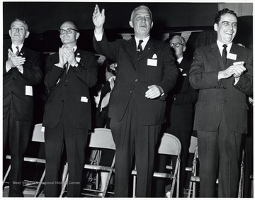 'Left to Right - Unknown, Senator John D. Hoblitzell, Jr., Senator Chapman Revercomb, Governor Cecil Underwood' at President Eisenhower's speech at the Kanawha Airport.