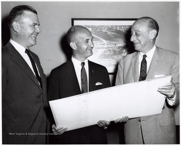Left to Right - Joseph Allen Overton, Jr., a Parkersburg lawyer at U.S. Dept. of Commerce under Eisenhower administration, Senator John D. Hoblitzell, Jr. and Louis S. Rothschild under the Secretary of Commerce for Transportation. Overton later became a president of the American Mining Congress.  They may well have been met to discuss the routing of West Virginia's first interstate.