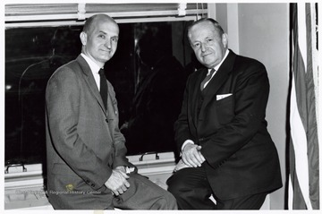 A photograph of Senator Hoblitzell (left) and Norman Mason (right), Commissioner of the Federal Housing Administration.