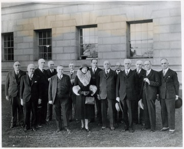 'Left to right: M. G. White, Gohen C. Arnold, C. W. Arnold, C. K. Payne, J. William Cummins, George A. Laughlin, Mrs. T. J. Pietro, unidentified man, Cass Gilbert, unidentified man, Gov. Conley, Bonner H. Hill, E. M. Keatley, and an unidentified man'