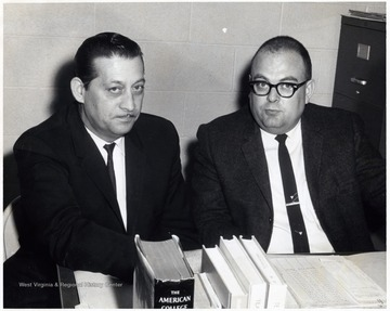 A photograph of Richard Dasher (right) sitting with an unidentified man.