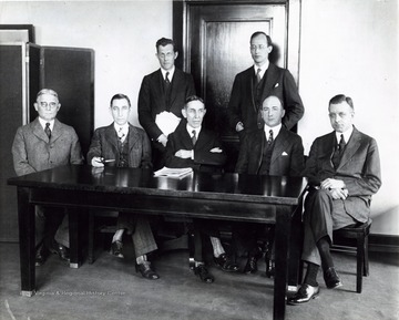 'Left to right, seated: Maj. Gen. Charles McKinley Saltzman, newly appointed member of the Federal Radio Commission representing the fourth zone; Judge Eugene O. Sykes, representing the third zone; Judge Ira. E. Robinson, chairman, representing the second zone; Harold A. Lafount, representing the fifth zone and William D. L. Starbuck, newly appointed, representing the first zone. Standing, Carl H. Butman, secretary of the commission and Bethuel Webster, general counsel to the Commission. The Federal Radio Commission composed of these men is now in special session considering radio legislation.'