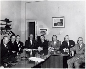 A photograph of the Board of Directors, including E. E. Hamstead (second from right) and Jim Rich (fourth from right).