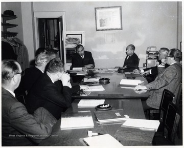 A photograph of a board meeting.  Among those pictured are Samuel Hayden (far right) and Lloyd C. Neilson (fourth from right).