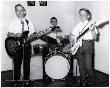 A photograph of three young boys, the Blosser youngsters, as a musical group.  They organized a Cancer Crusade.