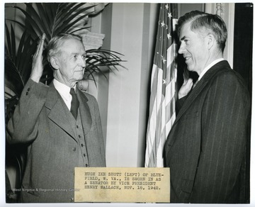 'Hugh Ike Shott (left) of Bluefield, W. Va., is sworn in as a senator by Vice President Henry Wallace.'