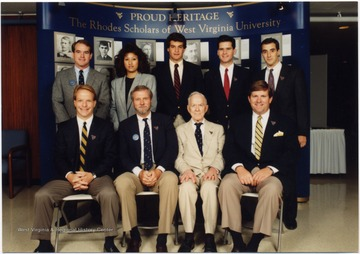 Group portrait of nine Rhodes Scholars from WVU. Front Row: Craig Underwood, Roger Tompkins (d), John Phillips (d), David Hardesty.  Back Row:  Daniel Williams, Barbara Harmon-Schamberger, Brian Glasser, Brad Hoylman, Thomas Gaziano.