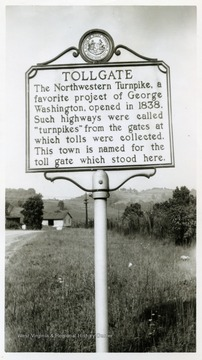 """Tollgate--The Northwestern Turnpike, a favorite project of George Washington, opened in 1838.  Such highways were called ""turnpikes"" from the gates at which tolls were collected.  This town is named for the toll gate which stood here."""