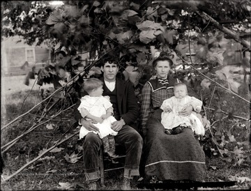 Man and woman with children on their laps.