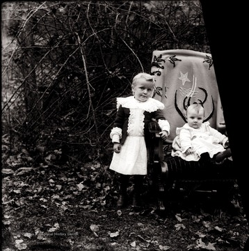 A portrait of two children taken outdoors in Helvetia, W. Va.