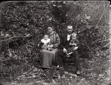 A portrait of a couple and their two children taken outdoor in Helvetia, W. Va.