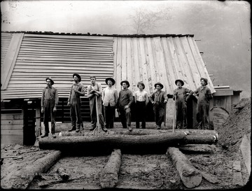 Loggers line up along the lumber mill in Helvetia, W. Va.
