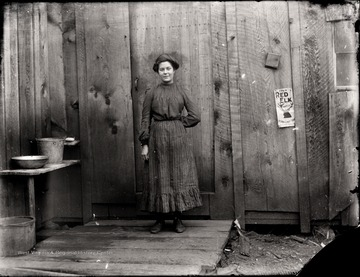 A portrait of woman taken outside of the back door in Helvetia, W. Va.