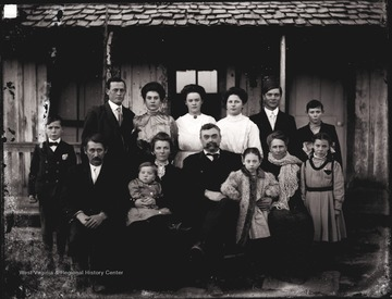 Photographer U. C. Shock moved his family from Helvetia to Arkansas around 1907 where his daughter Bess met Roscoe East. Roscoe and Bess are standing on the left in the photo.  They were later married and had three children.  Herbert Shock is standing on the left while his mother Mary is seated in front of Bess holding her son Charles.  Rilla Shock is standing on the right.  U. C. Shock later moved his family, less Bess, back to W. Va.