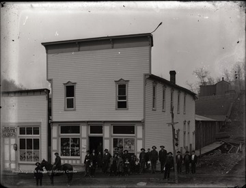 Pickens business pictured are D. G. Thomas Grocers and McNeal's Saloon.