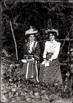 A portrait of two young women taken outdoors.