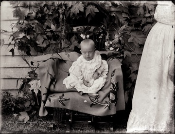 A portrait of infant in chair.