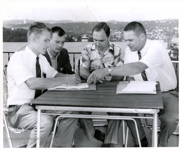 Group of men at patio table.