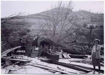 A woman stands on the site where a Methodist church used to stand, Mount Clare, W. Va.
