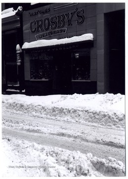 A view of Crosby's Jewelers' storefront during the Great Thanksgiving Snow in 1950; the store is on the south Third Street behind what would be New City in 1990.