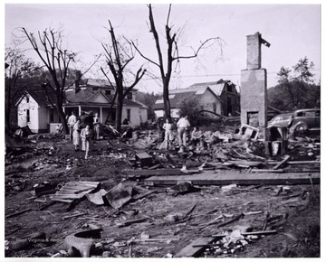 A view of Mount Clare after the tornado, people examine the site completely destroyed.