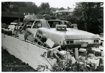 Shown here is a damage done on Betty Wyatt's car and garage by the tornado of August, 1970 in Bridgeport.  The photo was taken pointing to Virginia Avenue.
