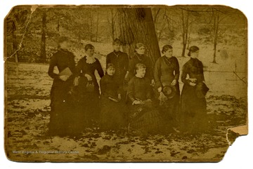 Those who identified are (Left to Right): Rene Smith, Lillie Jarvis (Mrs. Bruce Maxwell, Millie Smith, Carrie Mallonee (Mrs. Gordon Dayton), Laura Murray (Mrs. Frank Dixon).  Sitting: Charity Johnson, Willa Jarvis (Mrs. Paul Robinson).
