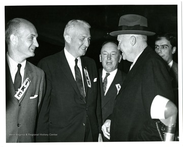 From left to right: Senator John D. Hoblitzell, Jr., Senator Chapman Revercomb, Unknown, President Dwight D. Eisenhower and governor Cecil Underwood.