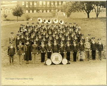WVU Band on old athletic field, and Women's Hall in the background. This location is now where the parking garage is located. '1st row left to right: 1. Director Walter Mestrezat, 3. Jane Green, 6. William (Ray) Broderick, and 14. Bernard McGregor. 2nd row left to right: 22. Edward Eilaud, and 23. Mack Allison. 5th row left to right: 47. Harold Case'