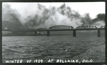 A view of a truss bridge over the Ohio River at Bellaire, Oh; taken in Winter of 1929.