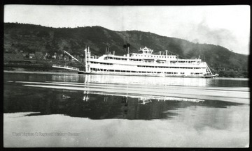 A river boat sails down on the Ohio River.