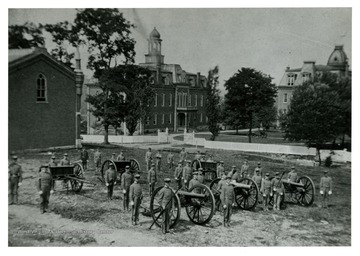 The University Cadet Corps with cannons in formation near Woodburn Circle.