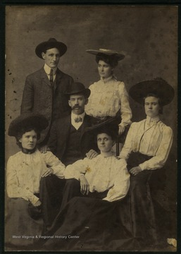 On the back of the photo: 'Man and Woman at top? Others left to right: Lou Hess Lumpert, James Andreus, Christy Gidley Reed, Florence Matthews and Mrs. Matthews. Mrs. Matthews worked at Morgantown Printing for many years.'