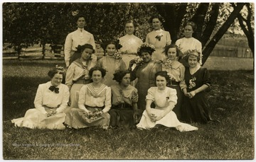 'Checked shirt 2nd from left front is Gertrude Hardway.'
