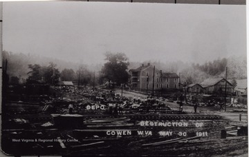 "Taken after the ""destruction of Cowen, May 30, 1911, day after first graduating class of Cowen High. Three story building was Central Hotel. It is located opposite of Adams Funeral Home."""
