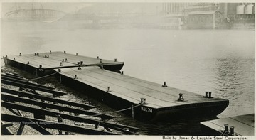 "On the front: ""Built by Jones and Laughlin Steel Corporation.""On the back: ""125'x 26'x6' 6"" 40 barges. Woods Brothers Construction Company, Lincoln, Nebraska."""
