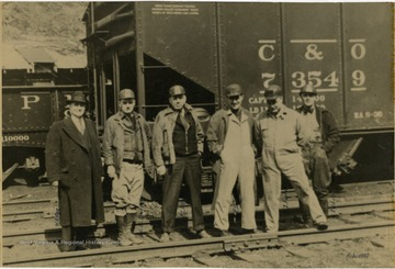 Left to right: W. A. Ogg, Ed B. Raigvel, F.C. Menk, Raymond E. Salvati, John J. Foster, Eddy C. Curris