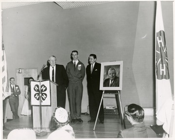 J. O. Knapp was Director of WVU Cooperative Extension Service and nationally recognized 4-H leader. In this portrait, J.O. Knapp is addressing the audience.