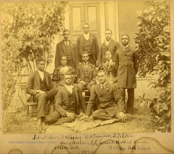 Graduates in front of building on Storer Campus. First Row: John Willson, R.H. Parker, W.A. Saunders, S.B. Ellis. Second Row: Daisy Nickens, A.L. Tollierer, Harriet Brown. Third Row: Charles Bell, N. Wiley, Pela Penick.