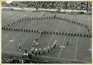 WVU Marching Band performing halftime field show.