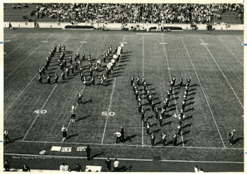 WVU Marching Band performing halftime field show. Forming the WV.
