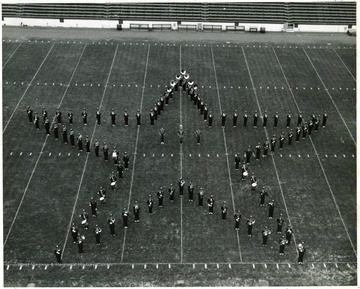 WVU Marching Band performing halftime field show. In star formation at the WVU-Syracuse game.