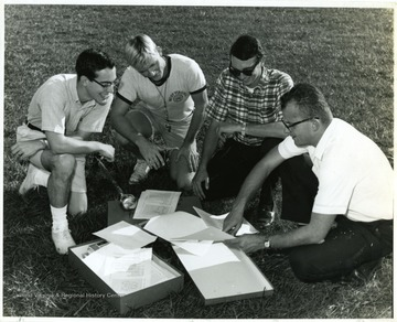 Members and staff looking over formations.