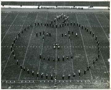 WVU Marching Band performs halftime field show. Formation in the shape of a pumpkin.